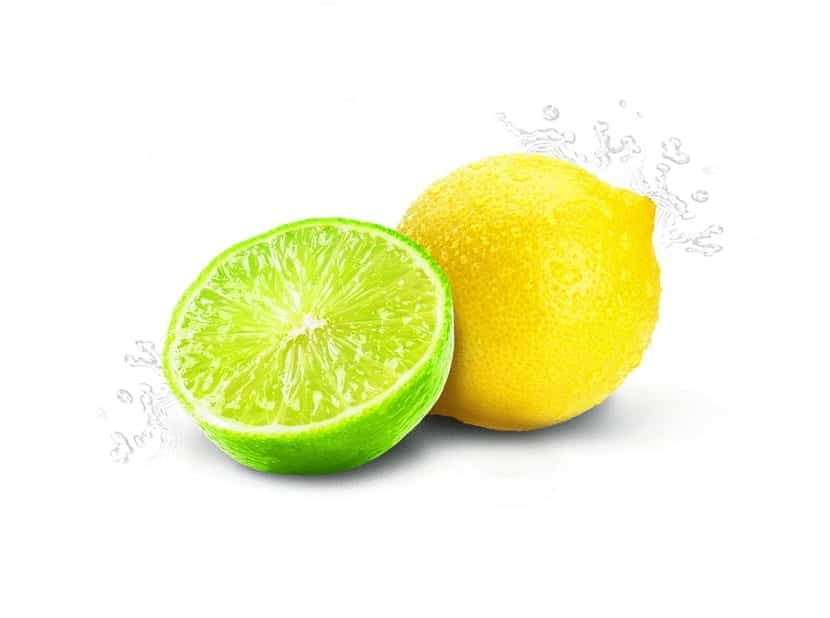lima cortada a la mitad junto a un limon con fondo blanco